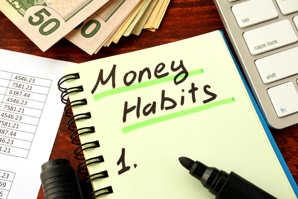 Money habits written in a notebook